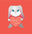 bunny in love holds a heart with the inscription vector image