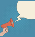 megaphone in hand and blank bubble speech vector image
