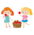 two girls eating red apples vector image