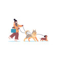 girl in mask walking with dogs woman having winter vector image