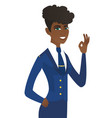 young african-american stewardess showing ok sign vector image vector image