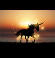 silhouette of a unicorn in a sunset landscape vector image vector image