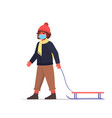 child in mask standing with sledge little boy vector image