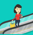 woman using smartphone on escalator in airport vector image vector image