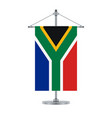 south african flag on the metallic cross pole vector image vector image
