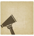 hand with megaphone symbol old background vector image