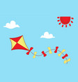 colored kite flies on background of blue sky vector image