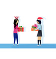 two asian women wearing hat deer horns giving vector image vector image