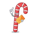 with envelope candy canes character cartoon vector image vector image