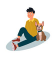 young man with dog sitting on floor vector image vector image