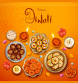 burning diya with assorted sweet and snack on vector image vector image