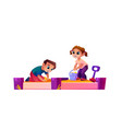 boy and girl playing in sandbox children game vector image vector image