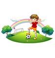 A boy in a soccer field vector image vector image