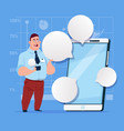 business man stand with big cell smart phone vector image
