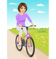 woman riding bicycle on a dirt road in countryside vector image