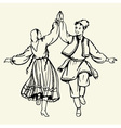 Couple dancing dressed in national costumes