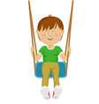 teenager boy riding a swing vector image