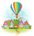 hot air balloon over the city with gifts vector image vector image