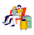young couple hugging on bench with luggage bags vector image vector image
