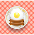 natural egg and two realistic boiled sausages top vector image vector image