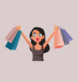 happy woman holding shopping bags cartoon vector image vector image
