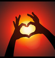 Love shape hands silhouette in sky vector image vector image