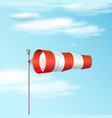 windsock on blue sky red and white airport vector image vector image