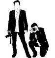 black silhouette of the photographer vector image