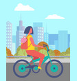 woman riding bicycle in summer park cityscape vector image vector image
