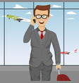 successful businessman with suitcase at airport vector image vector image