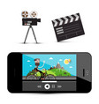movie player on smartphone camera and clapper vector image vector image