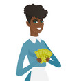 young african-american cleaner holding money vector image vector image