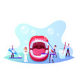 dental care concept tiny dentists characters vector image vector image