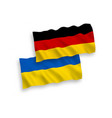flags of ukraine and germany on a white background vector image vector image