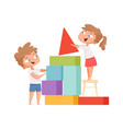 kids playing happy children build colorful cubes vector image