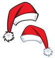 2 cartoon Santa hats vector image vector image