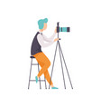 male photographer taking photo using professional vector image vector image