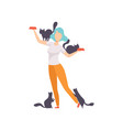 woman feeding her cats girl surrounded by black vector image vector image