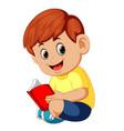 cute boy reading book vector image vector image