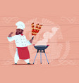 african american chef cook hold kebab smiling vector image vector image