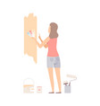woman picks color for paint wall with swatches vector image vector image