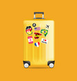 yellow travel luggage with stickers vector image