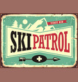 ski patrol retro sign design with mountain shape vector image