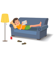 young man lying on couch with a tablet vector image vector image