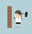 businesswoman breaking wall with hammer vector image