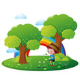 boy watering plant in the garden vector image vector image