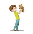 boy is playing with a teddy bear vector image