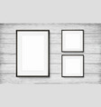 set black frames on wooden background vector image vector image