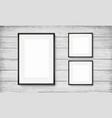 set of black frames on wooden background vector image vector image