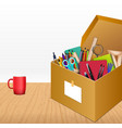 office accessories in a cardboard box on wooden ba vector image vector image
